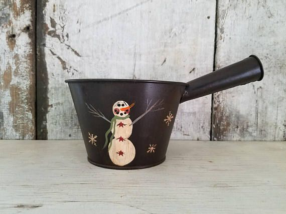 Size: 6 1/4 pan diameter plus and 4 high - use as Pot Fillers Frosty is painted in a vintage pan on both sides. Snowflakes or Snow Dots are around pan. Piece can be viewed from all sides. The hand painted snowmen are antiqued and sealed. You can use them as pot fillers, hold a table top fur tree or greens and berries. Bulbs were only for pictures and are not included. For Decorative Use Only. Most items in my shop are pre loved and show wear. The majority of my pieces are painted on s...