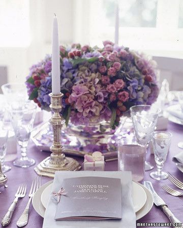 Multicolor mauve, blue, and pink hydrangea, as well as pink spray roses, make up this classic arrangement.