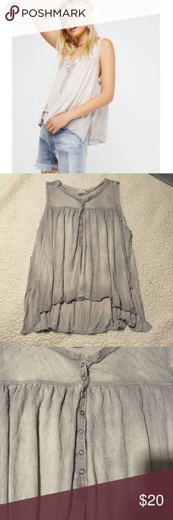 """Free People Hudson Tank Top in Sky Gray Size Small Adorable Free People Hudson Tank Top size small in Sky Gray. One tiny pin hole in the back (pictured) but totally not noticeable while wearing and priced accordingly for this sold out Top. Fastened with diminutive buttons, this long and slouchy tank has a special wash treatment and long and loose silhouette that can be draped and tucked just as you like. 21"""" front length; 25"""" back length Front snap closure Sleeveless 70% rayon, 30% linen…"""