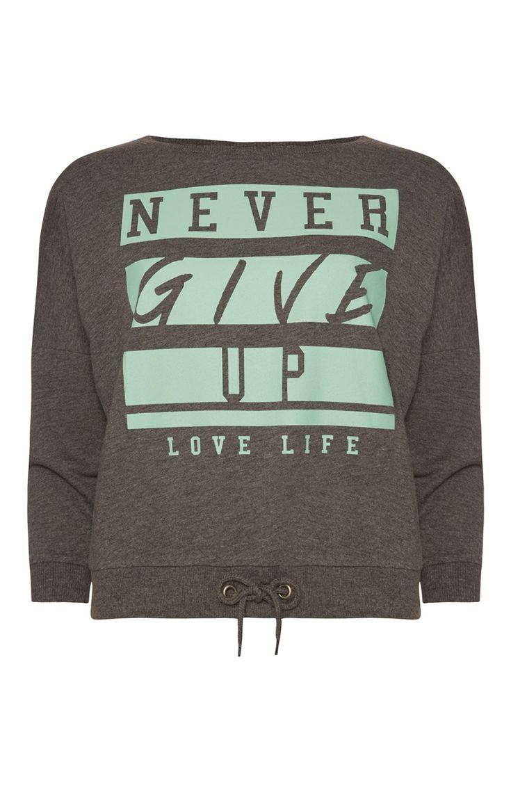 Primark - Sportieve grijze sweater Never Give Up