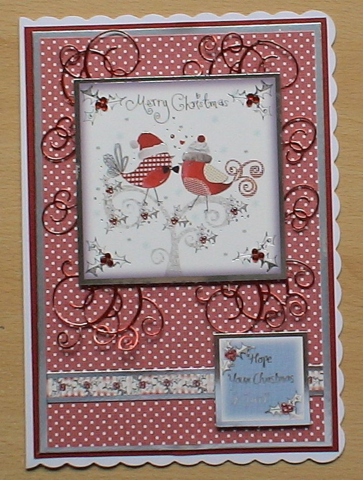 #hunkydory #createandcraft #spellbinders  The card is made using the Hunkydory 4 day deal christmas kit, I decorated it with swirls from a spellbinders die cut in red mirri card, and added a few adhesive red gems.