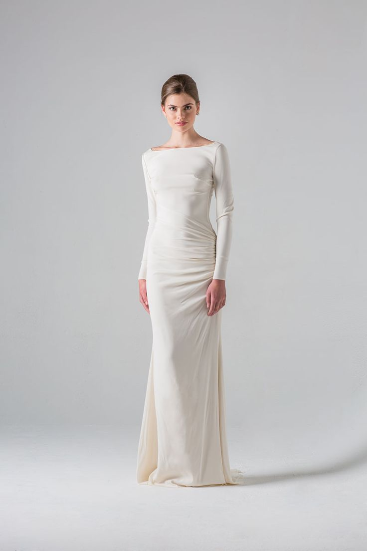 Anne Barge | Colmar | Long sleeve draped column gown with bateau neckline and low sheer back with beaded appliqué.