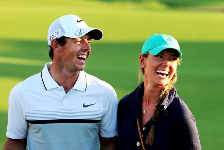 Rory McIlroy of Northern Ireland celebrates with his girlfriend Erica Stoll after winning the the DP World Tour Golf Championship in Dubai, on November 22, 2015.