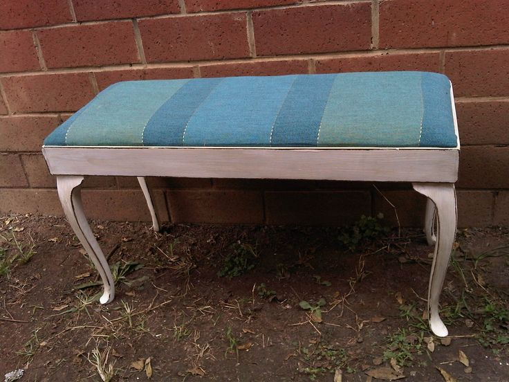 Antique Imbuia 2 Seater Bench in perfect condition with blue textil cover, painted in antique white with shabby chic finish. Measurements: H 46cm  x W 36cm x L86.  Newly restored, antique, solid wood furniture.  To view more items please visit my Facebook pages at: http://www.facebook.com/ArmstrongHomeDecor