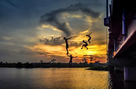 Sunset and kids. Photo by Nguyễn Trọng Bằng — National Geographic Your Shot