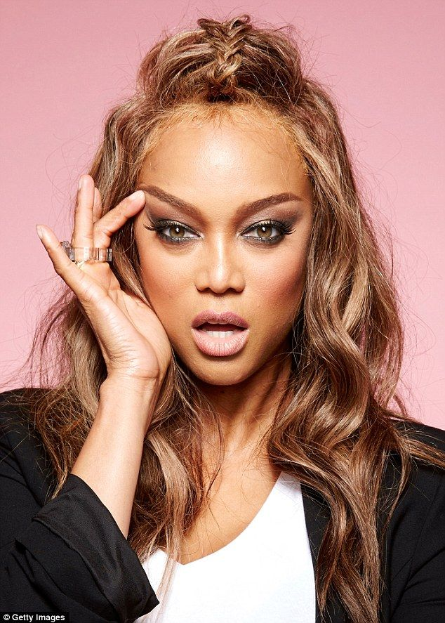 Stunner! Tyra's hazel eyes pierced through the shimmering eye shadow and she added a hint ...