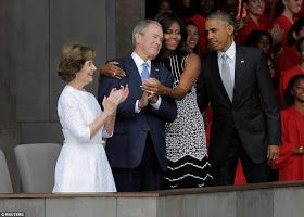 Us First Lady Michelle Obama and Former President George W Bush shared a sweet embrace at the opening of the Smithsonian National Museum of ...