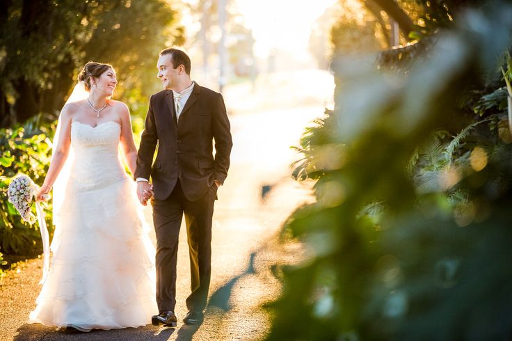The wedding couple walks through a tree tunnel to the Caversham House.