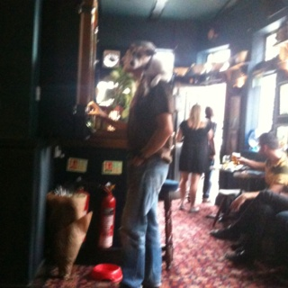 East End pub, complete with a dog lying on a man's shoulders! X