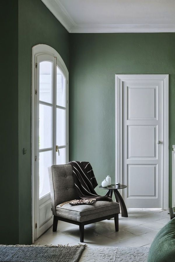 #curateandswoon Farrow and Ball Green Smoke Walls adds richness and warmth to this room. The wall paint works well with the dark wood furniture, the organic colours of the chair and the crisp white tiles and painted doors
