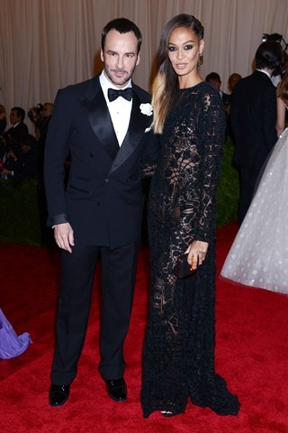 Tom Ford was accompanied by Joan Smalls, who wore a black dress of his design.