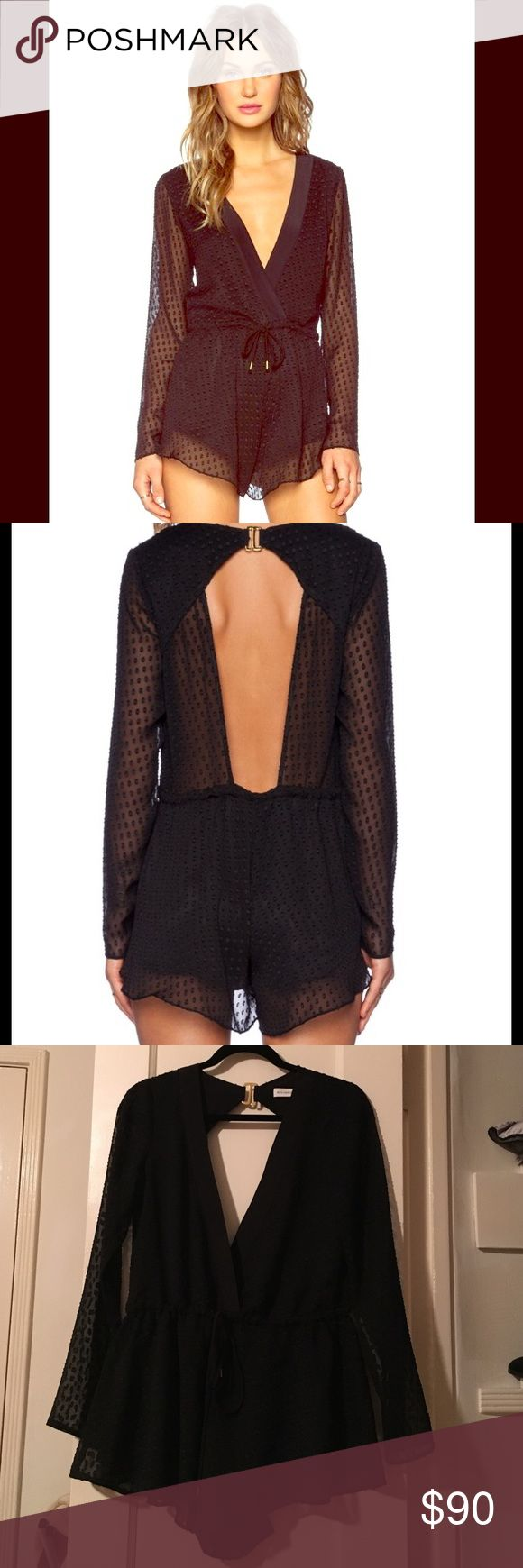 New! Bec & Bridge Black Nyx Long-Sleeved Playsuit This black super sexy and cute Playsuit is perfect for going out and special occasions. It has a deep v-neck, open back, and sheer lace sleeves. Bec & Bridge Dresses