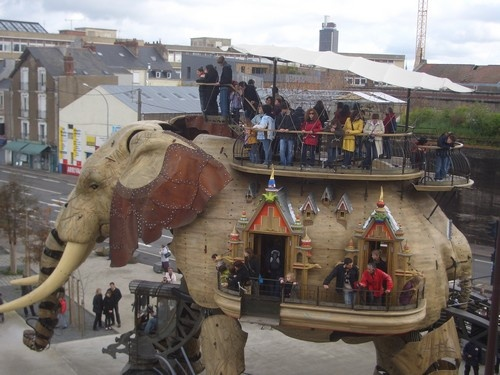 Le Robot Elephant - made from 25 tons of recycled materials.  It can carry up to 49  passengers.  Too cool!