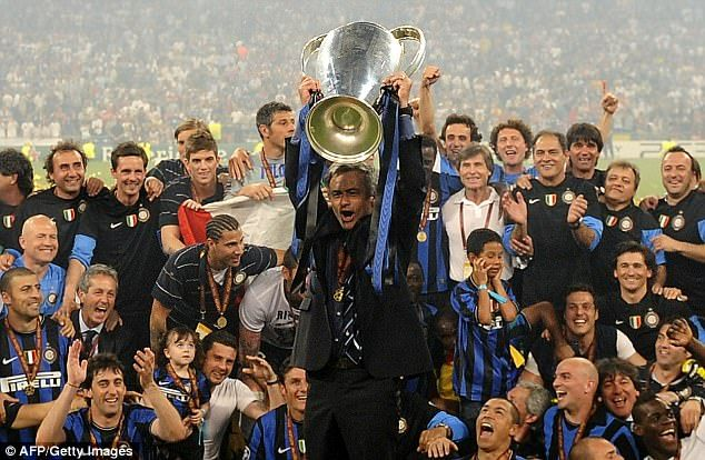 Jose Mourinho lifts the Champions League trophy with Inter Milan after they won in 2010
