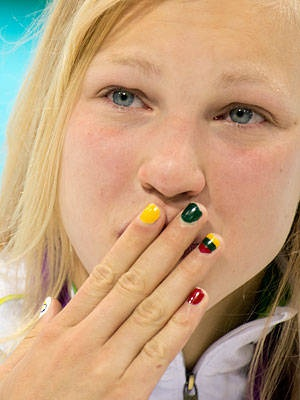 Light and Fair Ruta Meilutyte of Lithuania probably applied a little extra topcoat when she dressed up her digits — her national flag was still bright and clear after a dip in the pool when Meilutyte won the women's 100m breaststroke.