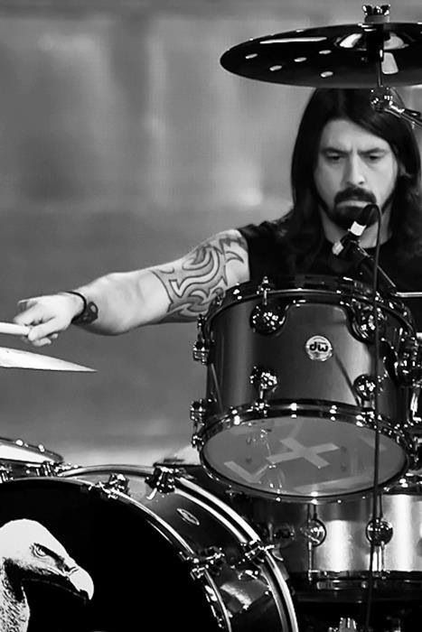 Dave Grohl on the Drums. He always says he is a hack guitarist and a drummer at heart!