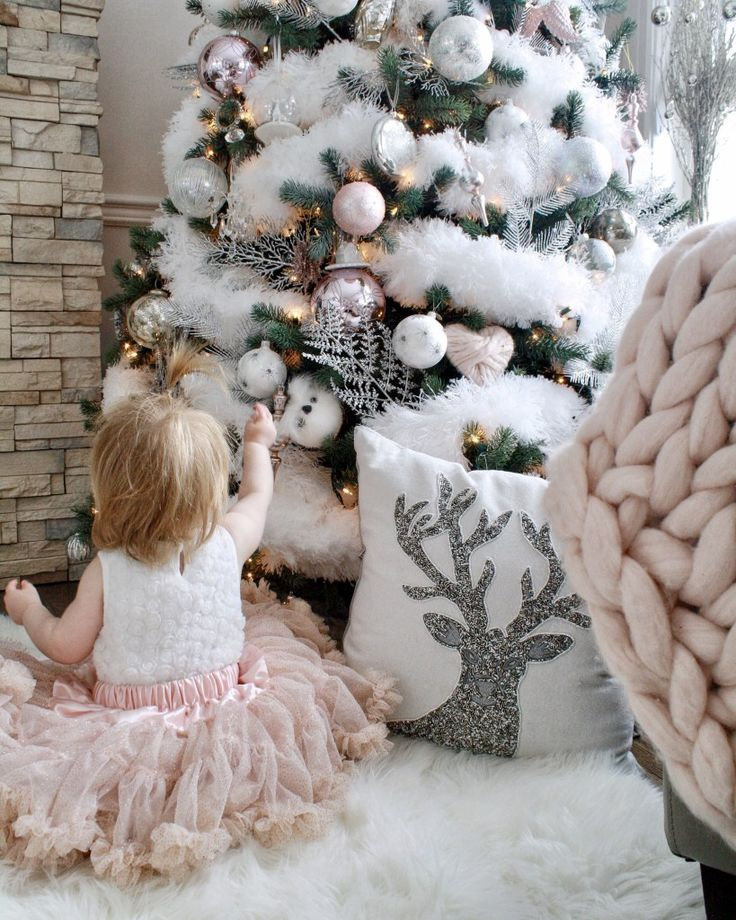 white and pink fluffy snow faux flocked Christmas tree - Chandeliers and Champagne Glam Christmas Home Tour