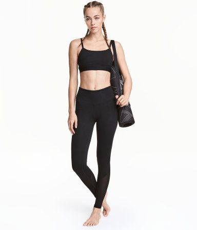 Black/mesh. Yoga tights in fast-drying functional fabric with wide ribbing at waist and mesh key pocket in waistband.