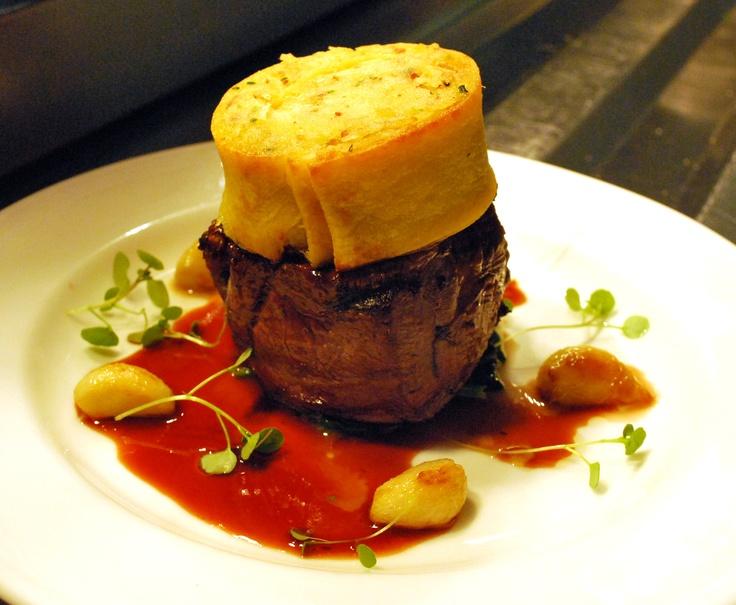 Beef fillet with potato, bacon crape, sauteed garlic and rich beef jus