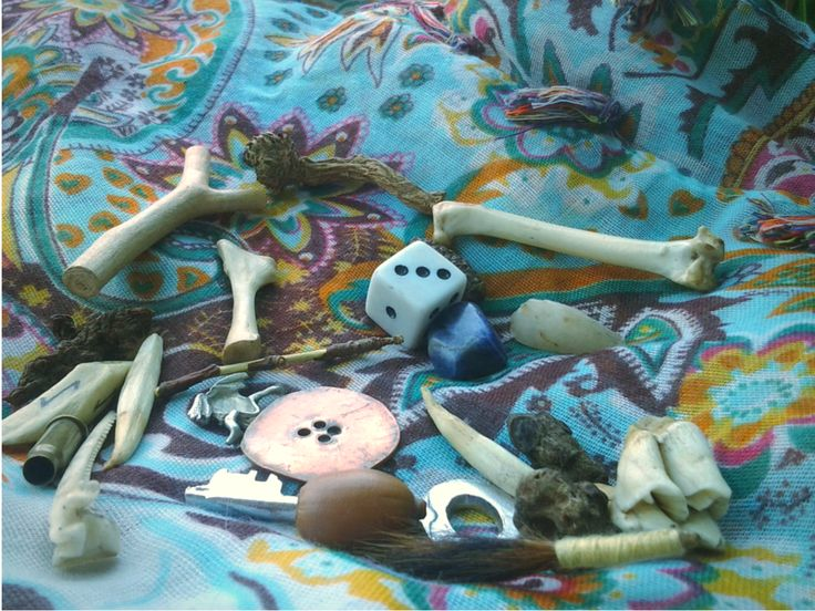 Some of the pieces in my bone kit. Each bone and curio contains a spirit with whom I speak in order to provide answers to questions and insight into situations. Find more on this divination method and a sample reading through the link.