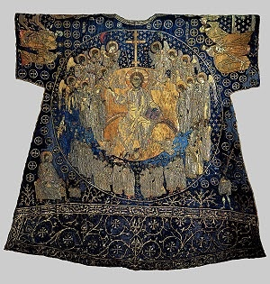 """The so-called """"Dalmatic of Charlemagne"""".  Eleventh century.  It is a masterpiece of the art of embroidery practiced in Constantinople during the eleventh century. It is not known how the legend grew that it was worn by Charlemagne for his coronation as Emperor in 800 AD. It is made entirely in embroidery with gold, silver and colored thread on blue silk with scenes from the Byzantine iconography of the ninth and tenth centuries."""