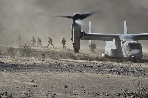 Dust bath. U.S. Marines exit a MV-22 Osprey during an embassy reinforcement exercise at a training area near Camp Lemonnier, Djibouti. The 13th Marine Expeditionary Unit Battalion Landing Team 1/4, performed riot control and force protection during the training scenario. The 13th MEU is deployed with the Boxer Amphibious Ready Group as a theater reserve and crisis response force including supporting Combined Joint Task Force-Horn of Africa. (Photo by Tech. Sgt. Chad Thompson, 26 OCT 2013.)