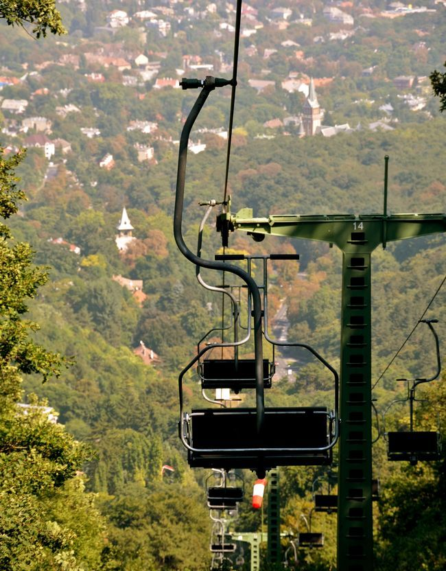 Libegő ― The Buda Hills has a variety of adventurous outdoor activities and the Libegő is one of Budapest's unique experiences. It is a two-way chairlift system that transports passengers between Zugliget and the lookout tower on János Hill (the highest peak in the city), providing beautiful panorama along the way. #Budapest #Libego