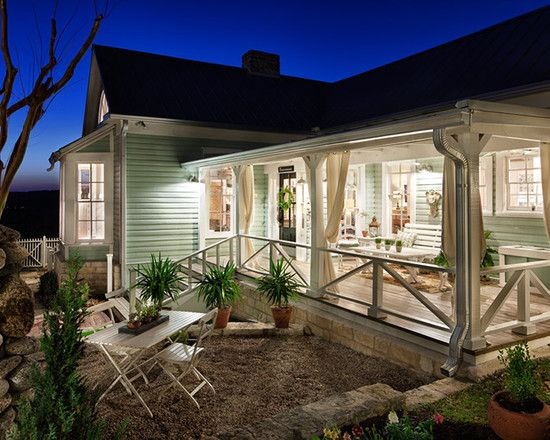 Renovated 1800s farmhouse in austin railing design for Ideas for covered back porch on single story ranch