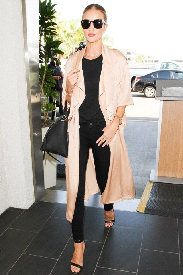 Rosie breaks up an all-black ensemble with a tan trench.