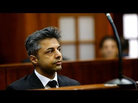Shrien Dewani appears in court at murder trial of his wife Anni as it begins.