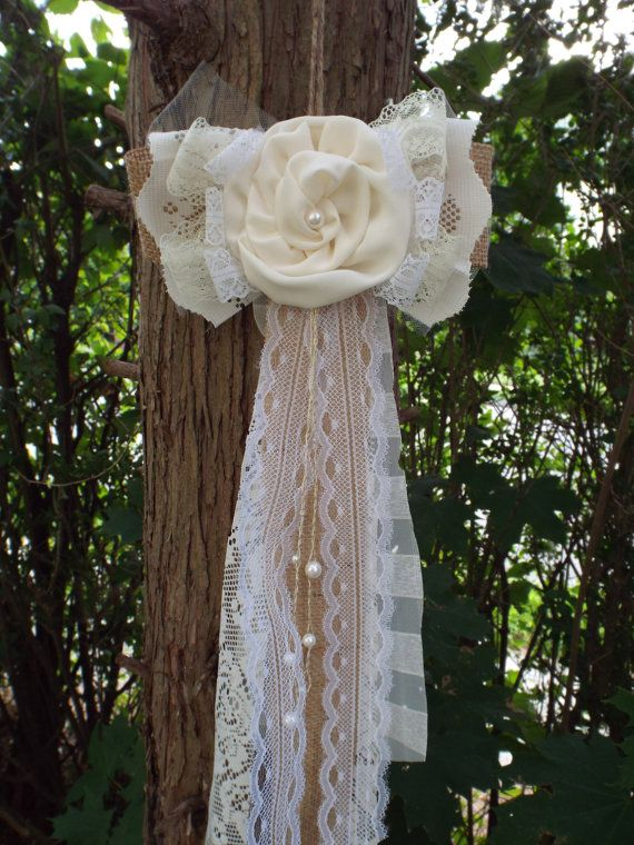 This adorable burlap and lace bow is sure to dress up your wedding ceremony! A breeze to install, these bow is a pleasant twist on the expected floral decoration  This beautiful bow is made of burlap, a handmade vintage white ribbon lace with satin rose, and long raw-edged burlap & ivory lace tails and pearls. Perfect for any cute addition to your home, wedding decor, honey teibel pew bows, wreath, gift, or window treatment! The uses are endless, use your imagination!  These are custom…