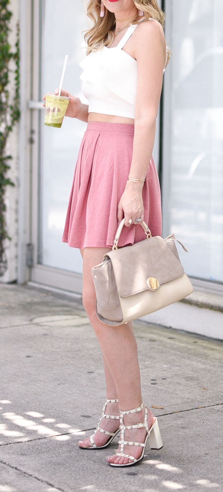 White crop top with a pink skater skirt and Valentino rockstud sandals for summer outfit ideas | what to wear | affordable style