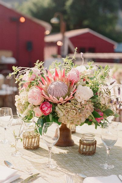 Amazing pink and green protea floral centerpiece {Photo: Merryl Brown Events via Project Wedding}