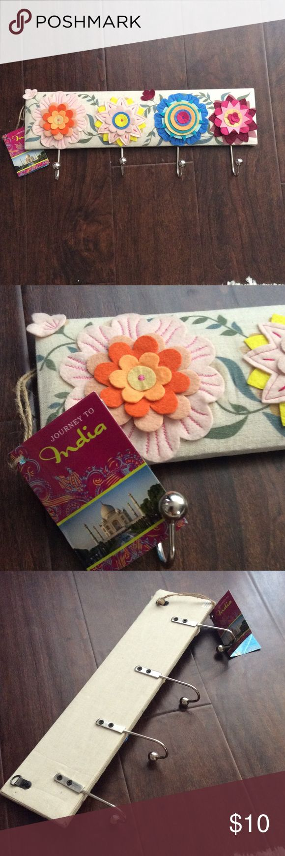 """Decorative Wall Holder for Jewelry or Accessories New! Got this from TJ Max, super cute wall decor to hang your jewelry or other dainty stuff. It is 18x 4.5"""" has 4 hooks and two back hoops for nails. Colorful flowers made of felt. Other"""