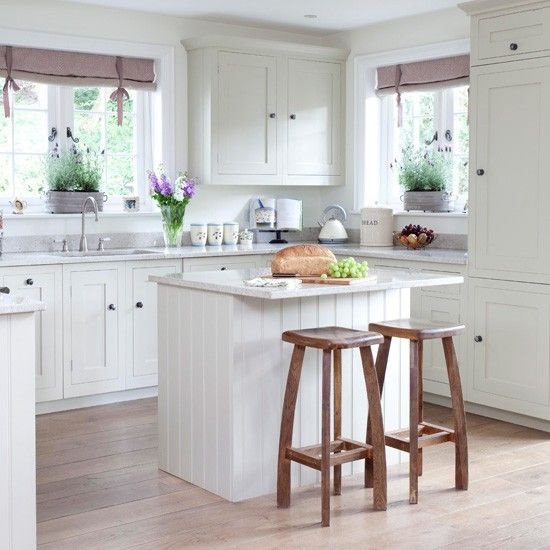 Shaker style breakfast bar Cool, calm and collected, a small island unit blends into the whole room scheme in this Shaker-style kitchen by continuing the tongue-and-groove finish. A pair of quirky stools are a great way of injecting some personality into a subtle look like this.