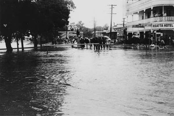 A flooded Coronation Drive in front of the Regatta Hotel, January 1974. Photo: Copyright State Library of Queensland/Author unknown