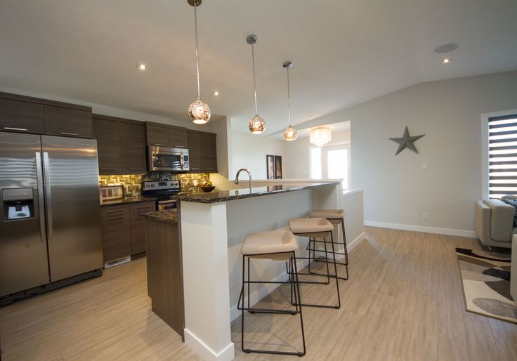 Cherrywood Showhome, Medium brown Kitchen with Island seating