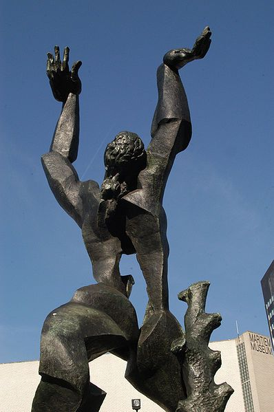 On the 14th of May in 1940 Rotterdam was bombarded, which practically destroyed the entire city center. The missing heart of the city inspired the artist Ossip Zadkine to make his famous statue 'De Verwoeste Stad' (ENG: The Destroyed City). A male figure has a hole in his chest, (his missing heart) and both arms are stretching skywards.