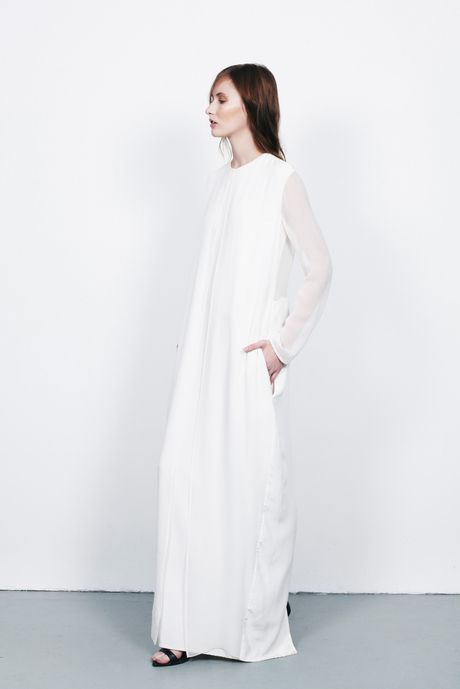 CHARLIE MAY White floor length gown with sheer panels. #minimal #fashion