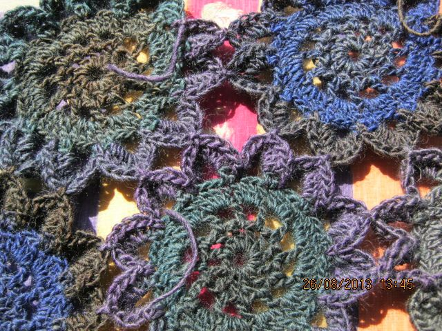 A shawl made with King Cole's RIOT yarn using the Japanese Flower pattern.