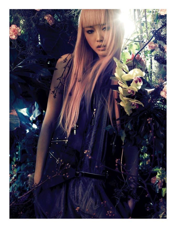 Showing her sleek bangs, Fernanda poses among botanical blooms for L'Officiel Singapore Magazine April 2016