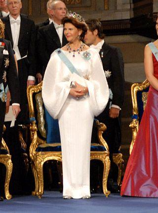 Queen Silvia at the 2006 Nobel Prize Award Ceremony in a white silk evening gown designed by Yuki (Gunyuki Torimaru).