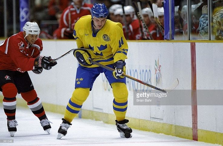 Steve Yzerman #19 of Team Canada skates after Mattias Norstrom #44 of Team Sweden during the 1998 Winter Olympic Games at the Big Hat Arena in Nagano, Japan. Mandatory Credit: Brian Bahr /Allsport
