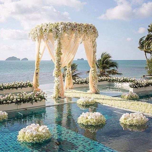 Over the water with over the top floral!? Yes, please @theweddingblissthailand !! #weddinginspo
