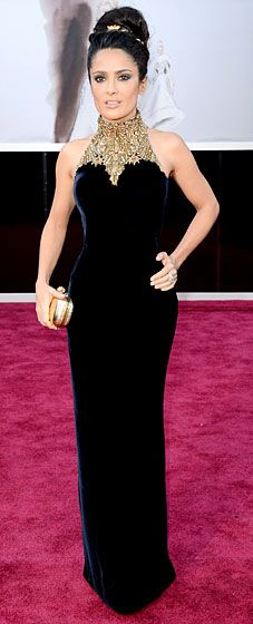 Salma Hayek donned Alexander McQueen's blue velvet gown with a gold embellished collar, and she carried the label's gold skull box clutch at the 2013 Oscars