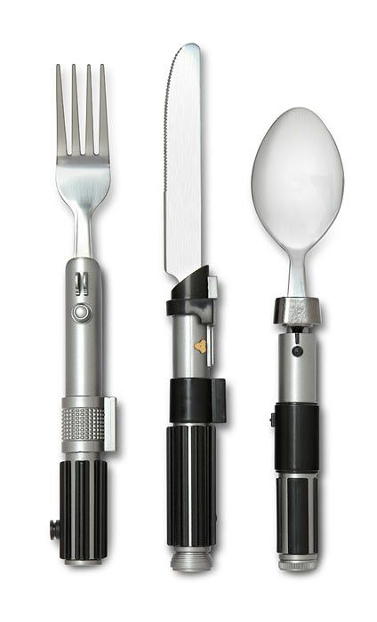 Make every meal a little bit more more civilized with this set of 3 utensils featuring lightsaber handles. The fork features Luke's lightsaber hilt, the spoon features Yoda's, and the knife features Vader's.
