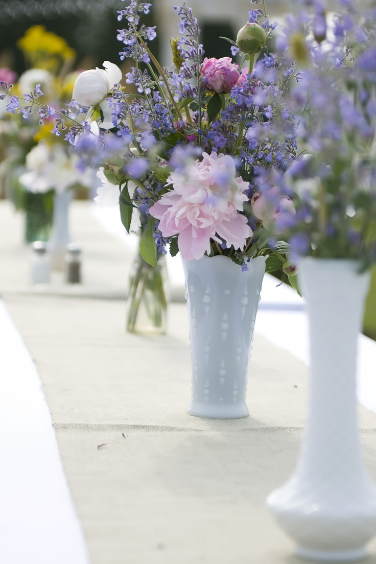 Purple and pink flowers in milk glass vases wildflower