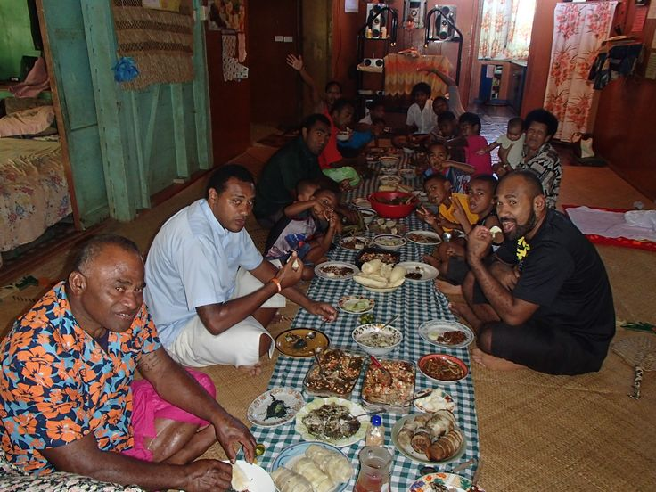 This Is An Image Of A Fijian Family Eating Either Their