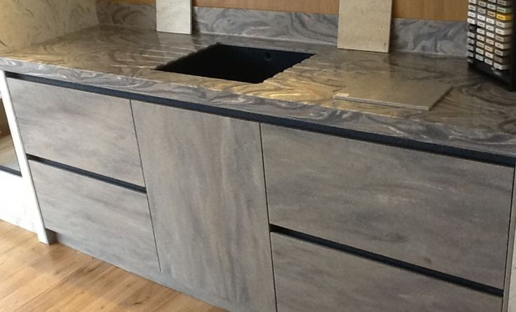 SFOS Showroom using Stone Series Corian® for Kitchen Doors and Drawers http://www.cdukltd.co.uk/