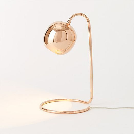 ROSE GOLD! With a slender profile and an open base that lets you use the desk space twice, the Scoop Table Lamp is perfect for perching over a pencil cup.